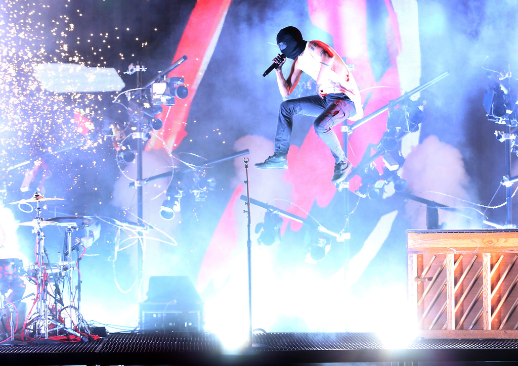 . Tyler Joseph of Twenty One Pilots performs a medley at the American Music Awards at the Microsoft Theater on Sunday, Nov. 20, 2016, in Los Angeles. (Photo by Matt Sayles/Invision/AP)