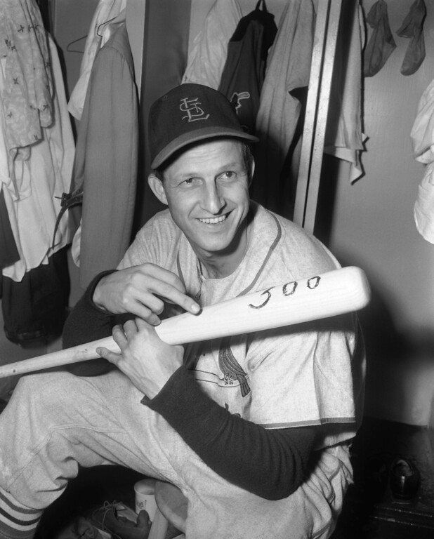. FILE - In this June 3, 1955, file photo, Stan Musial of the St. Louis Cardinals, holds bat with which he hit his 300th major league home run as he sits in clubhouse at Ebbets Field in New York, after the Cardinals 12-5 win over the Brooklyn Dodgers. Musial, one of baseball\'s greatest hitters and a Hall of Famer with the Cardinals for more than two decades, died Saturday, Jan 19, 2013, the team announced. He was 92. (AP Photo/Marty Lederhandler, File)