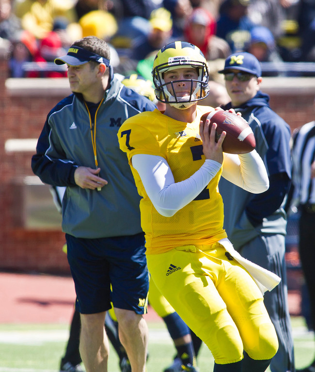 . Michigan quarterback Shane Morris (7) scrambles out of the pocket looking to throw a pass during the football team\'s annual spring game, Saturday, April 5, 2014, in Ann Arbor, Mich. (AP Photo/Tony Ding)
