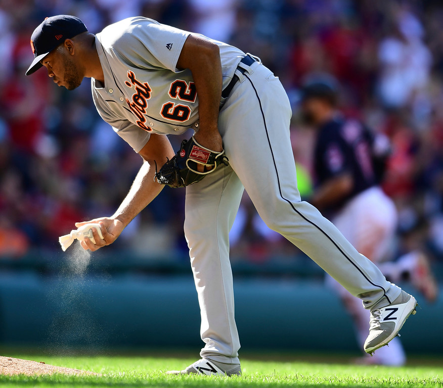 . Detroit Tigers relief pitcher Sandy Baez waits for Cleveland Indians\' Yonder Alonso to run the bases after hitting a two-run home run in the third inning of a baseball game, Saturday, Sept.15, 2018, in Cleveland. (AP Photo/David Dermer)