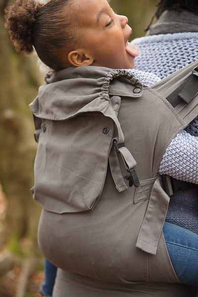 Izmi_Accessories_Lifestyle_Pocket_And_Hood_Mid_Grey_On_Mid_Grey_Toddler_Carrier_Close_Up.jpg