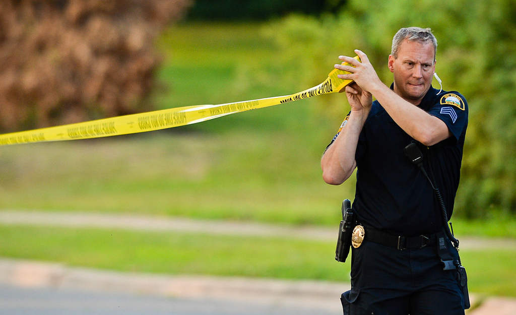 . An area near Robert Street in St. Paul was roped off after the suspect\'s car was found at a home on Wednesday, July 30, 2014. (Pioneer Press: Ben Garvin)