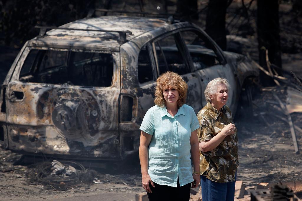 . Leanne Brown and her mother Rosemary Booth inspect the remains of her home following severe bush fires on October 18, 2013 in Winmalee, Australia.  (Photo by Lisa Maree Williams/Getty Images)