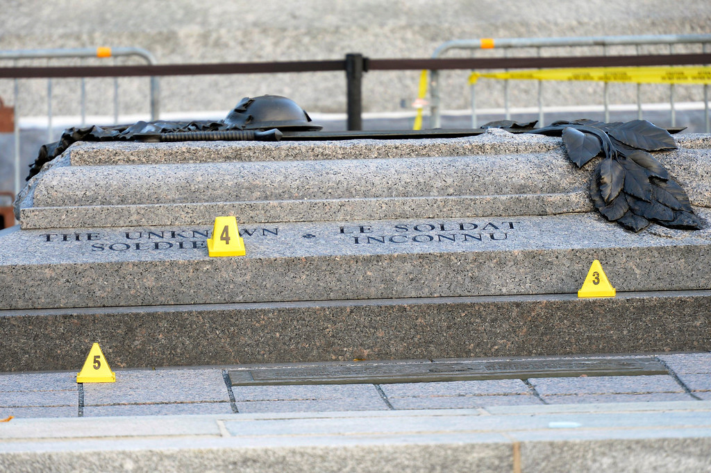. Evidence markers are placed around Tomb of the Unknown Soldier at the National War Memorial in Ottawa on Thursday Oct. 23, 2014.  (AP Photo/The Canadian Press, Adrian Wyld)