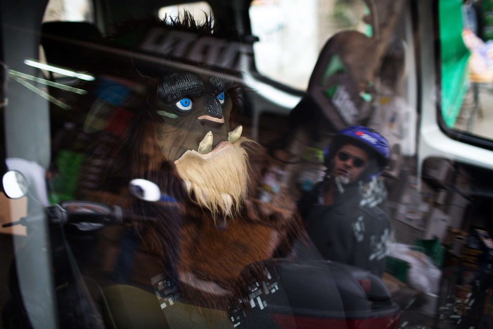 . A person dressed in a Purim costume sits in a car during celebrations of the Jewish holiday in Jerusalem on March 17, 2014.. The carnival-like Purim holiday is celebrated with parades and costume parties and drinking wine to commemorate the deliverance of the Jewish people from a plot to exterminate them in the ancient Persian empire 2,500 years ago, as recorded in the Biblical Book of Esther. (MENAHEM KAHANA/AFP/Getty Images)