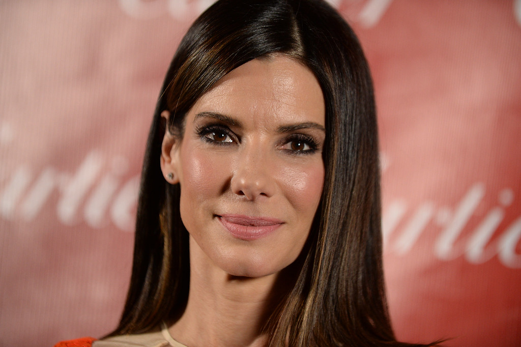 . Sandra Bullock poses backstage at the Palm Springs International Film Festival Awards Gala at the Palm Springs Convention Center on Saturday, Jan. 4, 2014, in Palm Springs, Calif. (Photo by Jordan Strauss/Invision/AP)