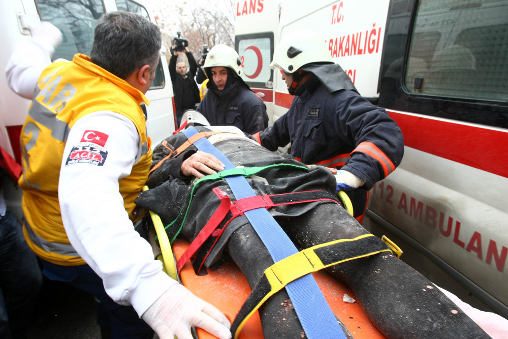 . Rescuers take on February 1, 2013 a victim of a blast outside the US Embassy in Ankara to a waiting ambulance. Two security guards were killed in the blast outside the US embassy, local television reported, amid speculation it was a suicide attack. The force of the explosion damaged nearby buildings in the Cankaya neighborhood where many other state institutions and embassies are also located.  AFP PHOTO / ADEM  ALTAN/AFP/Getty Images