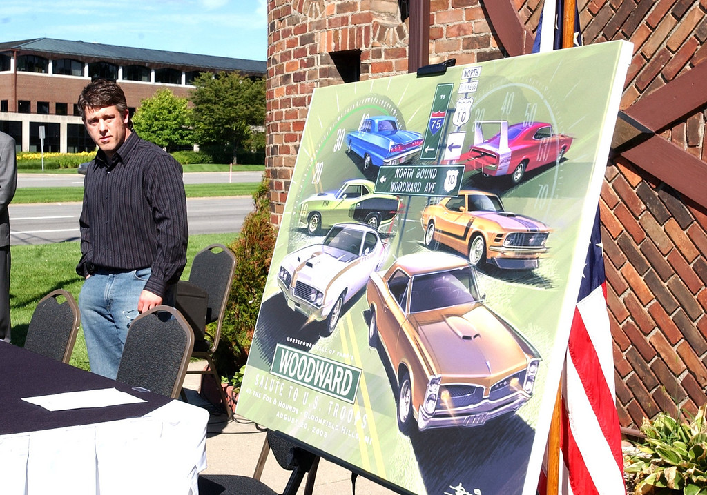 ". Artist Jason Bliss of Orion Twp. at the unveiling of his poster for the 2005 Dream Cruise  ""Salute To The Troops\"" at the Fox and Hounds restaurant in Bloomfiled Hills.  The third annual cruise poster proceeds go to Michigan Nation Guard Family Fund."