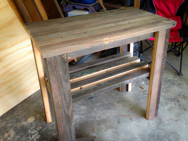 Outdoor potting table! Made from reclaimed barn wood.