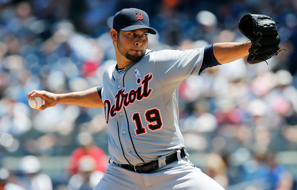 . Detroit Tigers starting pitcher Anibal Sanchez (19) winds up in the first inning of a baseball game against the New York Yankees at Yankee Stadium in New York, Sunday, June 21, 2015. (AP Photo/Kathy Willens)
