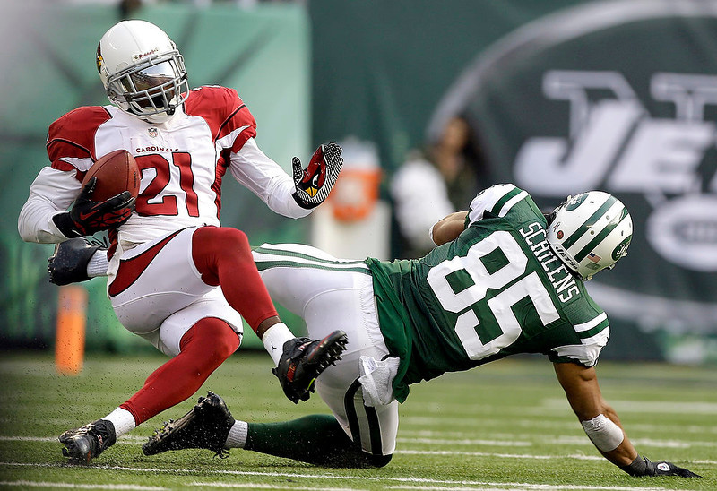 . Arizona Cardinals cornerback Patrick Peterson (21) intercepts a pass which was intended for wide receiver Chaz Schilens (85) during the first half of an NFL football game, Sunday, Dec. 2, 2012, in East Rutherford, N.J. (AP Photo/Kathy Willens)