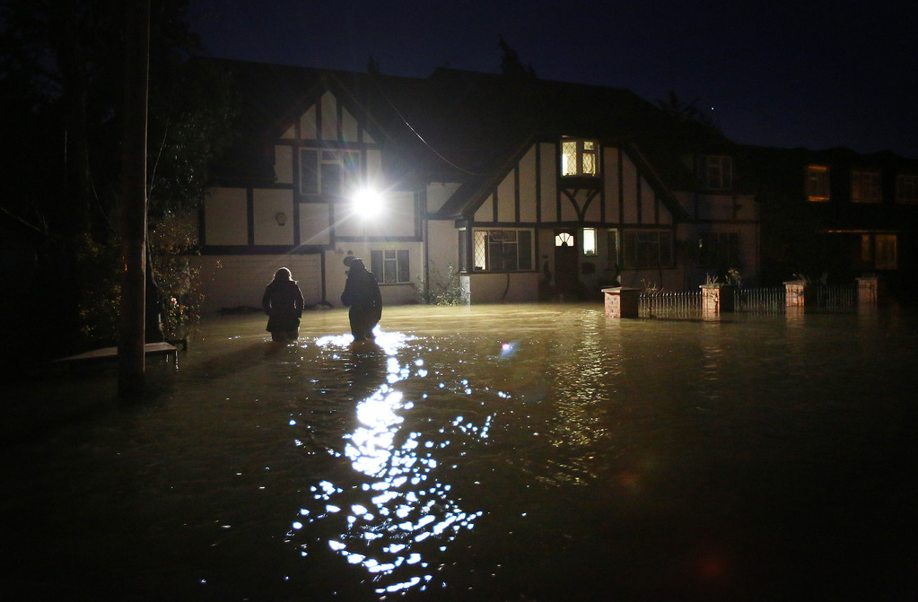 . Flooded homes remain occupied where residents still have electricity as night falls on February 11, 2014 in Wraysbury, England. Some say that they will stay in their houses even though they have been offered help to evacuate as flood water rises.  (Photo by Peter Macdiarmid/Getty Images)
