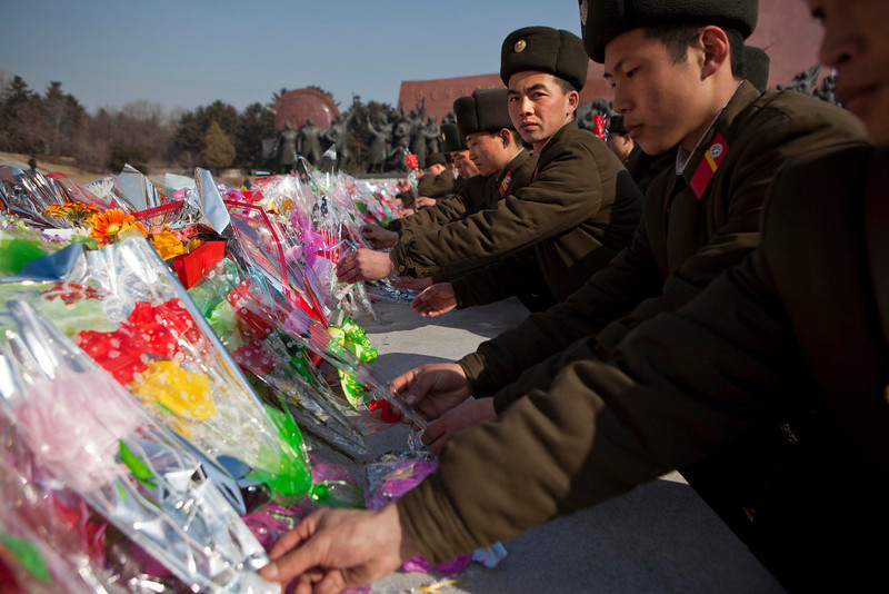 . North Korean soldiers lay flowers at the base of bronze statues of the late leaders Kim Il Sung and Kim Jong Il to pay their respects in Pyongyang, North Korea on Saturday, Feb. 16, 2013. North Koreans turned out to commemorate what would have been the 71th birthday of Kim Jong Il who died on Dec. 17, 2011. (AP Photo/David Guttenfelder)