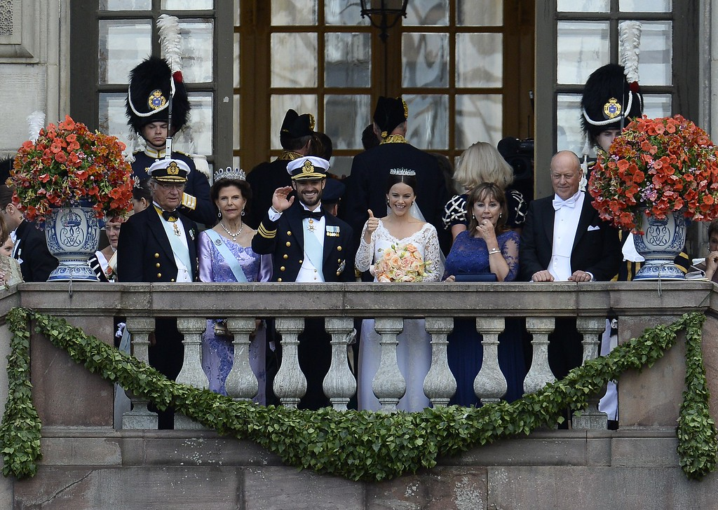 . Sweden\'s Princess Sofia (C, R) together with Sweden\'s Prince Carl Philip (C, L) wave to the crowd from the balcony after their wedding ceremony next to the bridegroom\'s parents Sweden\'s King Carl XVI Gustaf and Sweden\'s Queen Silvia and the bride\'s parents  Marie Hellqvist and Erik Hellqvist at Stockholm Palace on June 13, 2015. AFP PHOTO / JONATHAN NACKSTRAND/AFP/Getty Images