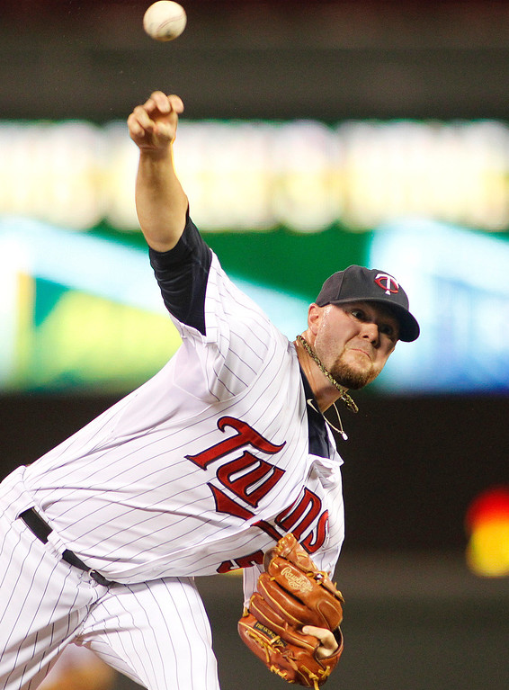 . Minnesota Twins pitcher Casey Fien throws against the Los Angeles Angels in the 9th inning of their baseball game won by the Twins 6-3 in Minneapolis Monday, Sept. 9, 2013.(AP Photo/Andy Clayton-King)