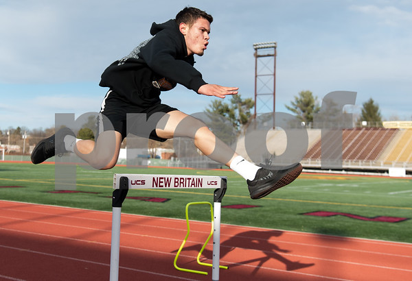02/26/18 Wesley Bunnell | Staff NBHS Senior Carlos Villarini runs the hurdles as the rest of his indoor track team spent Monday afternoon holding outdoor practice at Veterans' Stadium taking advantage of the mild weather.