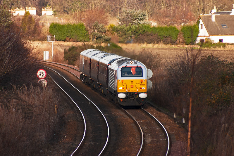 The train sat in Thornton loop for 30 minutes while other traffic passed it.  Now it passes the Boreland and nears Dysart as it continues back to Toton depot , Nottingham.
