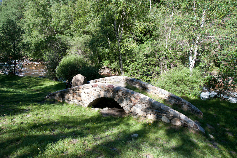 Creek and stone bridge in Andorra