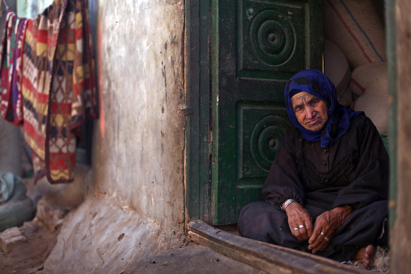 . An elderly Palestinian refugee sits at the entrance of her house in Gezirat al-Fadel village, Sharqiya, about 150 kilometers (93 miles) east of Cairo, Egypt.  (AP Photo/Khalil Hamra)