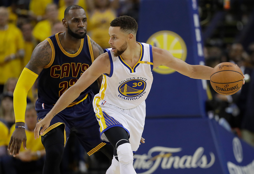 . Golden State Warriors guard Stephen Curry (30) is guarded by Cleveland Cavaliers forward LeBron James during the second half of Game 1 of basketball\'s NBA Finals in Oakland, Calif., Thursday, June 1, 2017. (AP Photo/Marcio Jose Sanchez)
