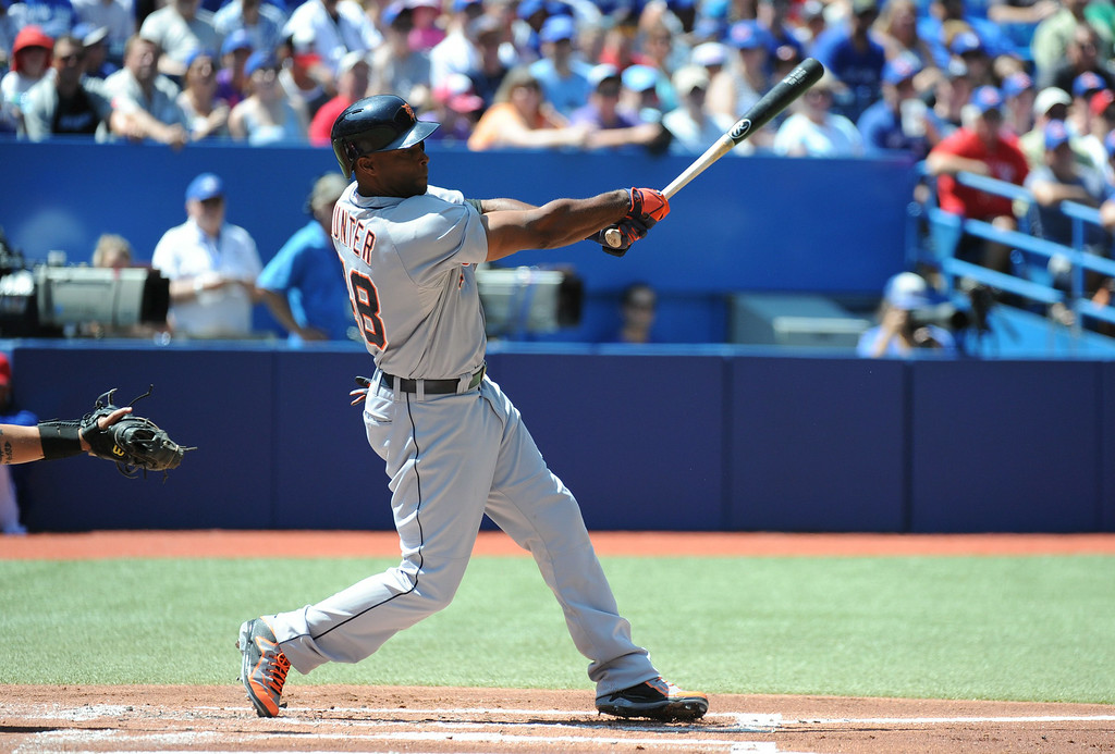 . Detroit Tigers\' Torii Hunter hits a two-out single against the Toronto Blue Jays during the first inning of a baseball game on Sunday, Aug. 10, 2014, in Toronto.  (AP Photo/The Canadian Press, Jon Blacker)