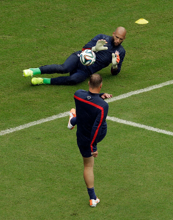 . United States\' goalkeeper Tim Howard gets warmed up before the group G World Cup soccer match between the USA and Germany at the Arena Pernambuco in Recife, Brazil, Thursday, June 26, 2014. (AP Photo/Hassan Ammar)