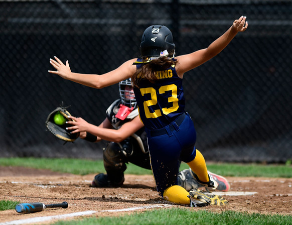 7/20/2019 Mike Orazzi | Staff New Jersey's Madison Manning (23) scores during Little League softball with Rhode Island at Breen Field in Bristol on Saturday.