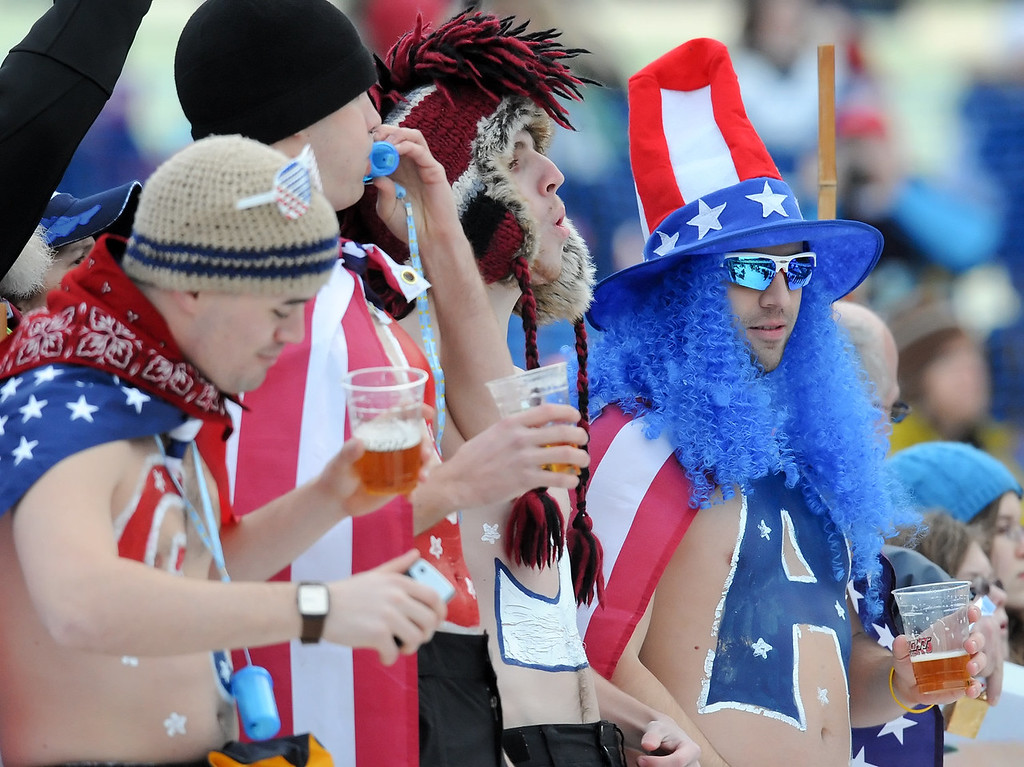 . USA supporters chant during the run 2 of the women\'s Luge Singles at Whistler Sliding Center on February 15, 2010 during the Vancouver Winter Olympics.   AFP PHOTO / LEON NEAL
