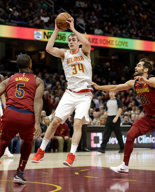 . Atlanta Hawks\' Tyler Cavanaugh (34) drives between Cleveland Cavaliers\' JR Smith (5) and Cleveland Cavaliers\' Jose Calderon (81), from Spain, in the first half of an NBA basketball game, Tuesday, Dec. 12, 2017, in Cleveland. (AP Photo/Tony Dejak)