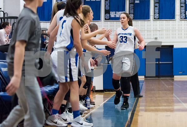 02/15/18 Wesley Bunnell | Staff Southington girls basketball defeated E.O. Smith 68-51 Thursday night at Southington High School in a CCC Tournament contest. Janette Wadolowski (33) is welcomed by the bench as she exits late in the game.