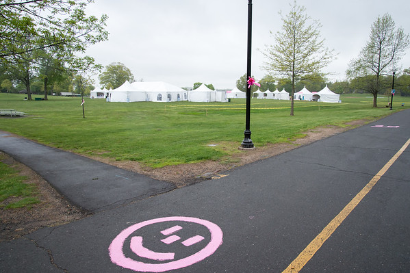 05/10/19 Wesley Bunnell | Staff A smiley face is painted in the road to provide motivation heading towards the start/finish line for Saturdays Race in the Park being held at Walnut Hill Park. The race is held yearly at Walnut Hill Park and benefits the Connecticut Breast Health Initiative.