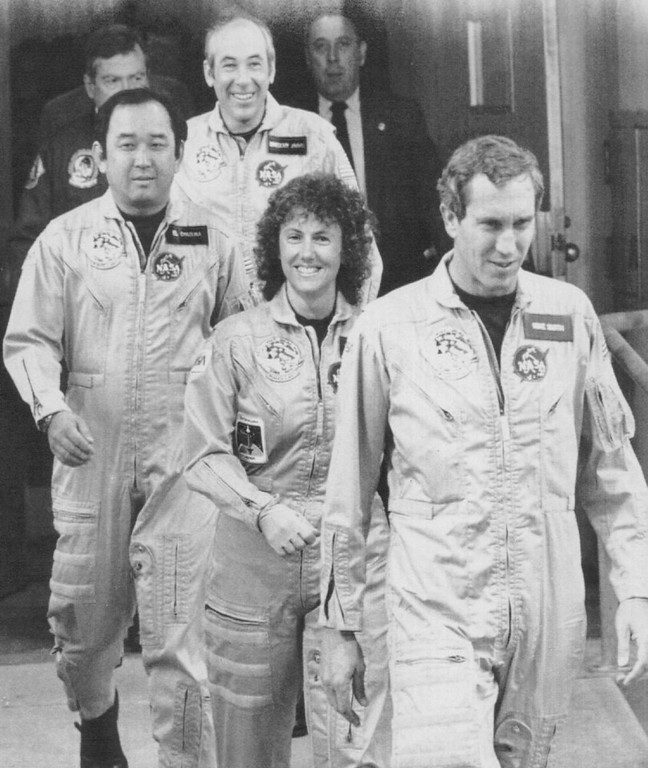 . The crew of Space Shuttle 51-L walks out from their quarters en route to the Space Shuttle orbiter Challenger early Tuesday morning for a 2nd attempt at launch. Credit: AP Laserphoto