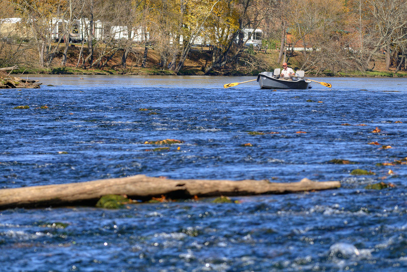 A lone fisherman in a boat begins to navigate the shoals of the Wataua River at Sycamore Shoals State Park in Elizabethton, TN on Friday, November 1, 2013. Copyright 2013 Jason Barnette