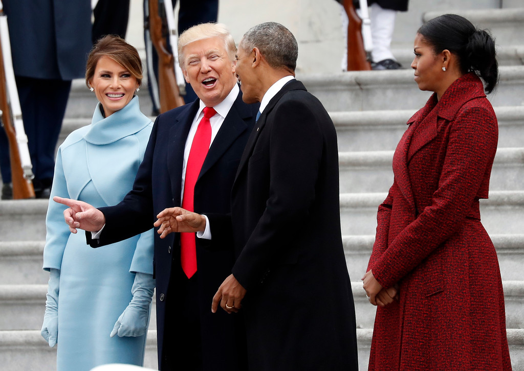 . President Donald Trump and first lady Melania Trump talk with former President Barack Obama and Michelle Obama during a departure ceremony on the East Front of the U.S. Capitol in Washington, Friday, Jan. 20, 2017, after Trump was inaugurated. (AP Photo/Alex Brandon)