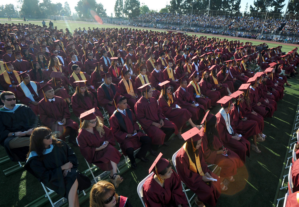 . Seniors receive their diplomas during La Serna High School\'s 51st Annual Commencement at La Mirada High School stadium in La Mirada on Thursday June 13, 2013. La Serna marked the commencement of 635 graduates and marking Principal Ann Fitzgerald\'s first graduation as principal. (SGVN/Staff Photo by Keith Durflinger)
