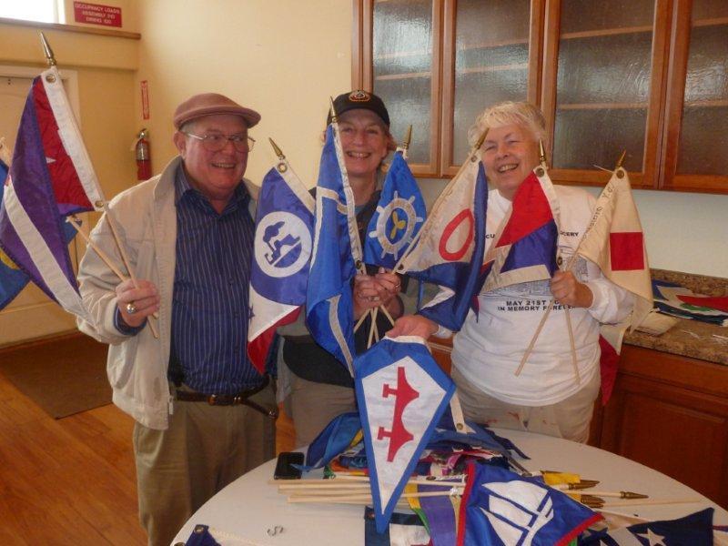 Terry, Peggy, Liz mounting burgee's.jpg