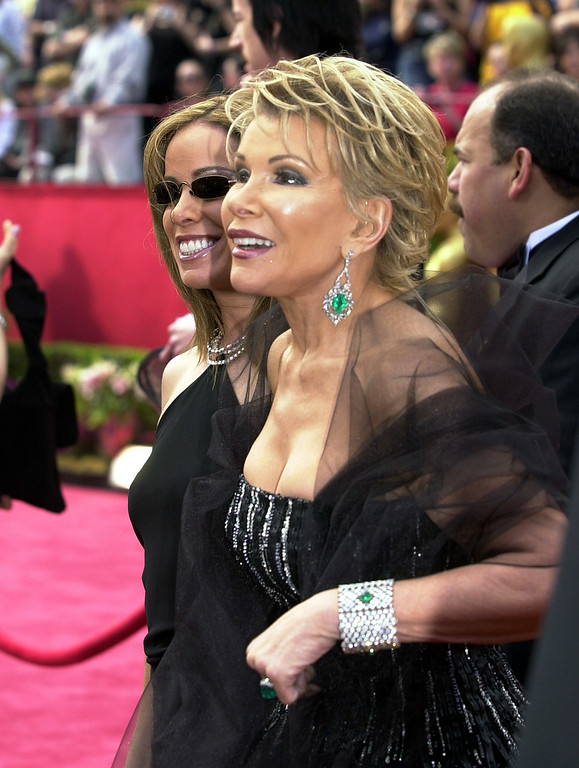 . Joan Rivers, right, and daughter Melissa from E! Televison arrive on the red carpet before the 74th annual Academy Awards on Sunday, March 24, 2002, in Los Angeles. (AP Photo/Laura Rauch)