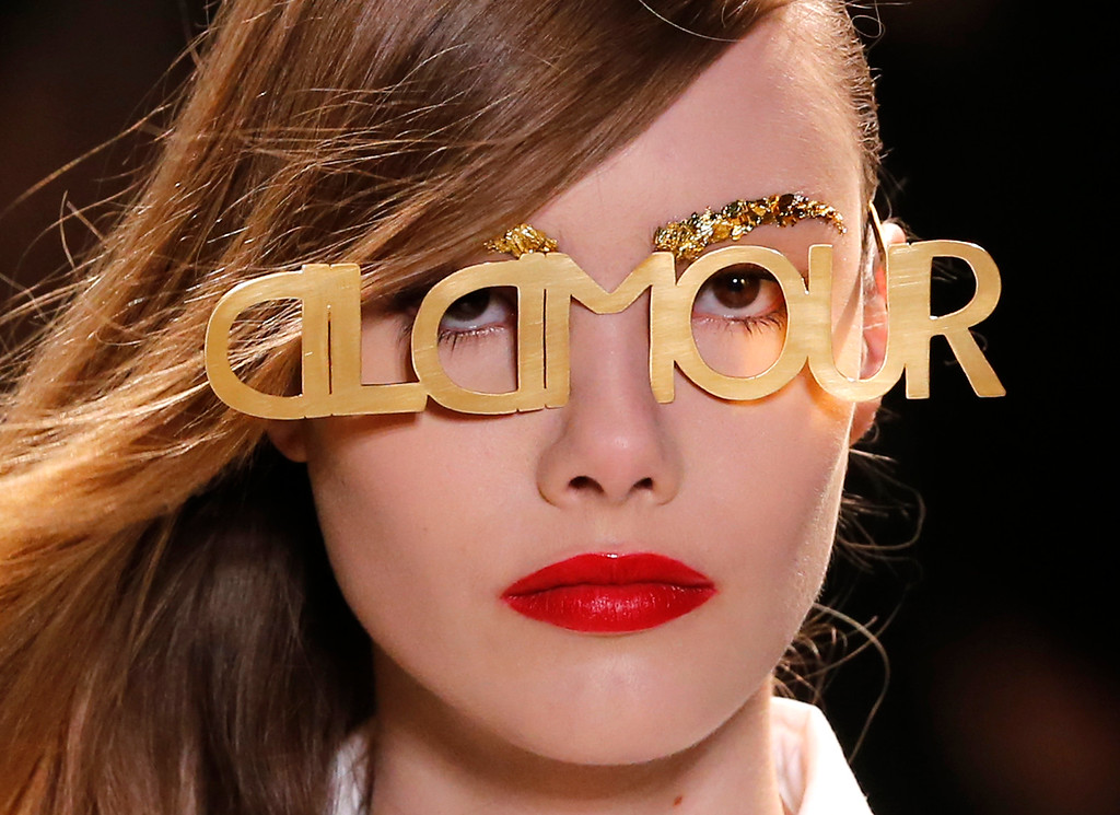 . A model wears glasses for Jean-Charles de Castelbajac\'s ready-to-wear Spring/Summer 2014 fashion collection, presented in Paris, Tuesday, Oct.1, 2013. (AP Photo/Jacques Brinon)