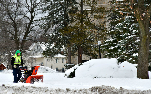 12/4/2019 Mike Orazzi | Staff Bristol Parks and Recreation employees remove snow along sidewalks near Federal Hill in Bristol on Wednesday.