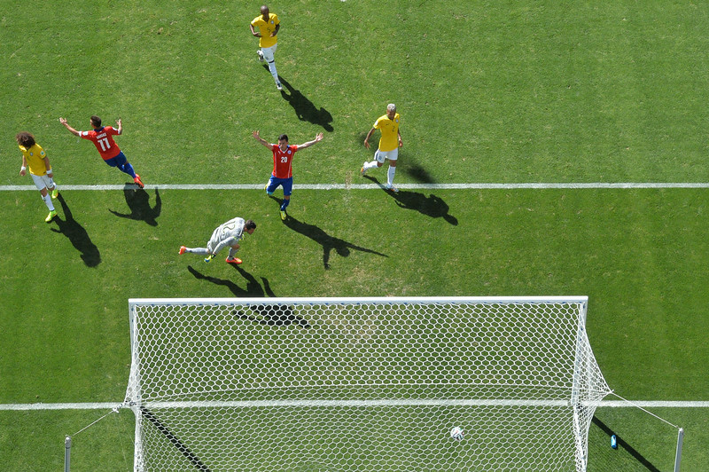 . Chile\'s forward Eduardo Vargas (2nd-L) and midfielder Charles Aranguiz (C) celebrate after their team scored a goal during the round of 16 football match between Brazil and Chile at The Mineirao Stadium in Belo Horizonte during the 2014 FIFA World Cup on June 28, 2014. (FRANCOIS XAVIER MARIT/AFP/Getty Images)