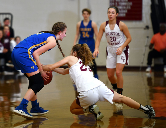 12/31/2019 MIke Orazzi | StaffrBristol Central's Ella Watson (23) and Gilbert's Samantha Lukowski (11) during Tuesday's girls basketball game at Bristol Central in Bristol.