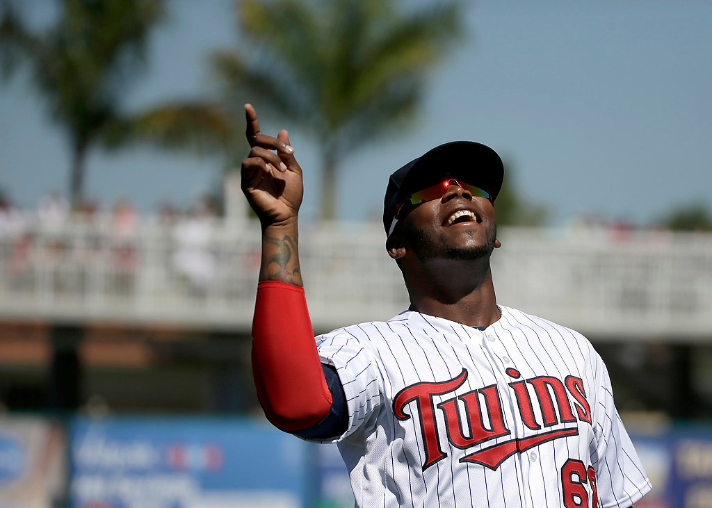. Minnesota Twins first baseman Kennys Vargas laughs while warming up on the field before an exhibition baseball game against the Boston Red Sox, Saturday, March 1, 2014, in Fort Myers, Fla. (AP Photo/Steven Senne)