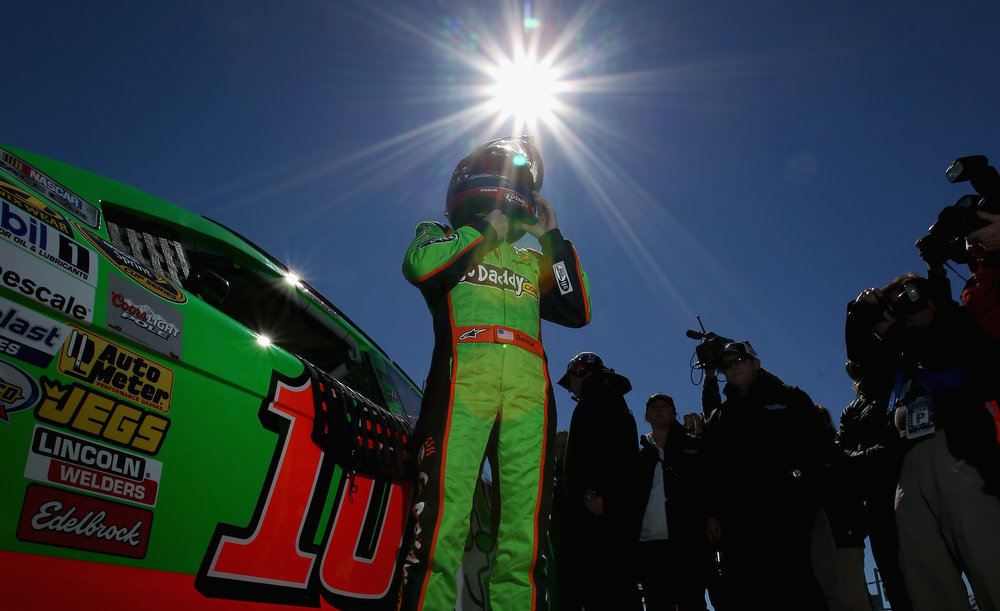 Description of . Danica Patrick, driver of the #10 GoDaddy.com Chevrolet, gets out of her car after qualifying for the NASCAR Sprint Cup Series Daytona 500 at Daytona International Speedway on February 17, 2013 in Daytona Beach, Florida.  (Photo by Jonathan Ferrey/Getty Images)