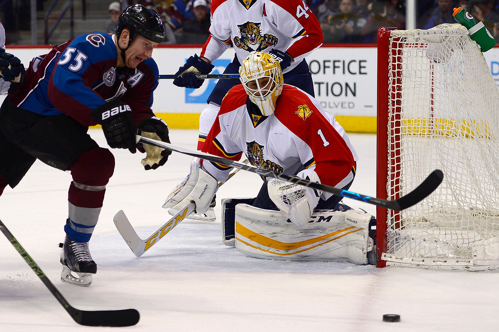 . DENVER, CO - MARCH 3: Colorado Avalanche left wing Cody McLeod (55) tries to grab the puck while Florida Panthers goalie Roberto Luongo (1) guards the goal during the first period at the Pepsi Center on March 3, 2016 in Denver, Colorado. (Photo by Brent Lewis/The Denver Post)