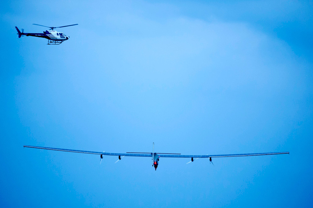 """. The new experimental aircraft \""""Solar Impulse 2\"""" with Solar Impulse\'s German test pilot Markus Scherdel on board takes off during the first flight at the airbase in Payerne, Switzerland, early Monday, June 2, 2014. The aircraft HB-SIB is the second solar plane of the Solar Impulse project. (AP Photo/Laurent Gillieron, pool)"""