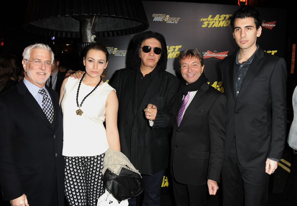 ". Lionsgate Motion Picture Group co-chairman Rob Friedman, Sophie Simmons, musician Gene Simmons, Lionsgate Motion Picture Group co-chairman Patrick Wachsberger, and Nick Simmons arrive at the premiere of Lionsgate Films\' ""The Last Stand\"" at Grauman\'s Chinese Theatre on January 14, 2013 in Hollywood, California.  (Photo by Kevin Winter/Getty Images)"