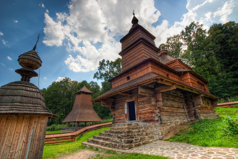Wooden Church    What would I do without a wide-angle lens :). It's absolutely great to be able to stand close to a building and still get it into the shot. This is one of the wooden churches in the open air museum in Bardejovske Kupele.  HDR from three shots, taken with Canon 450D with Sigma 10-20mm lens, from a tripod.