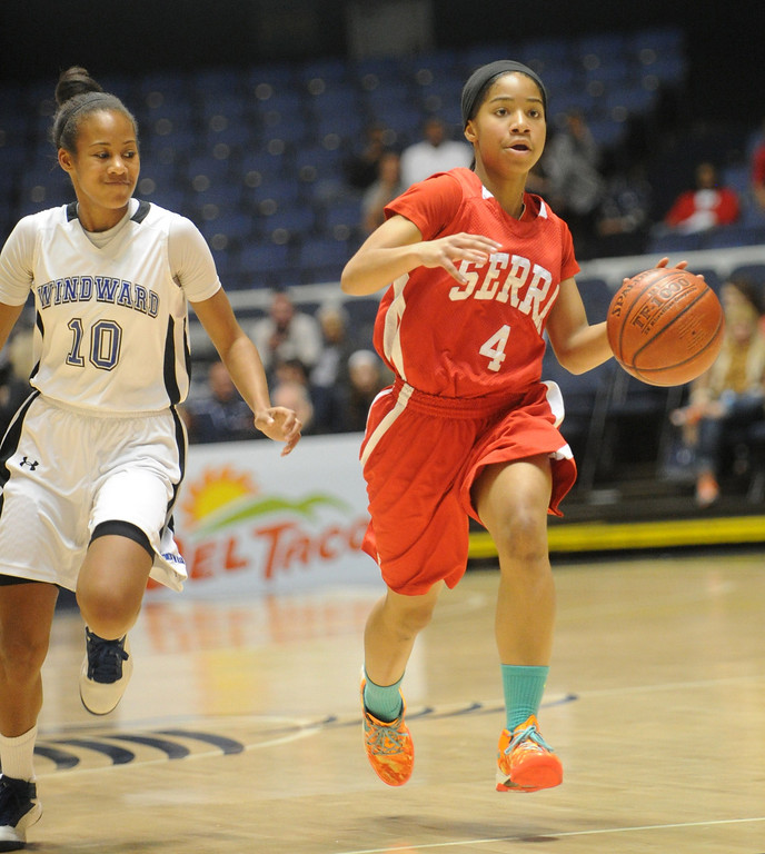 . 02-27-2012--(LANG Staff Photo by Sean Hiller)- Serra vs. Windward in Wednesday\'s girls basketball CIF SS Div. 4AA title game at the Anaheim Convention Center Arena in Anaheim. Serra\'s Deandrea Toler (4) drives down court ahead of Windward\'s Courtney Jaco  (10).
