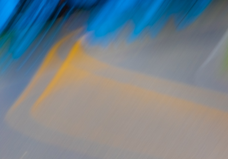 Streaked double yellow lines on a road of an abstract photo simulate the view of a drunk driver