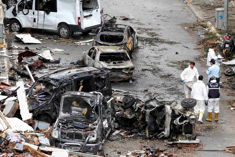 . Officials work on one of the scenes of the twin car bomb attacks in the town of Reyhanli of Hatay province near the Turkish-Syrian border May 12, 2013. Twin car bombs killed 43 people and wounded many more in a Turkish town near the Syrian border on Saturday and the government said it suspected Syrian involvement. The bombing increased fears that Syria\'s civil war was dragging in neighboring states despite renewed diplomatic moves towards ending two years of fighting in which more than 70,000 people have been killed. The bombs ripped into crowded streets near Reyhanli\'s shopping district in the early afternoon, scattering concrete blocks and smashing cars in the town in Turkey\'s southern Hatay province, home to thousands of Syrian refugees. REUTERS/Umit Bektas